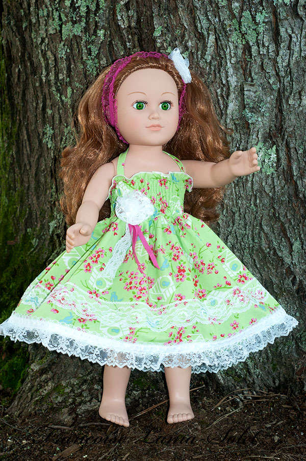 Colorful set composed of a green, pink floral dress and a headband for 18 or 23 inch dolls Spring
