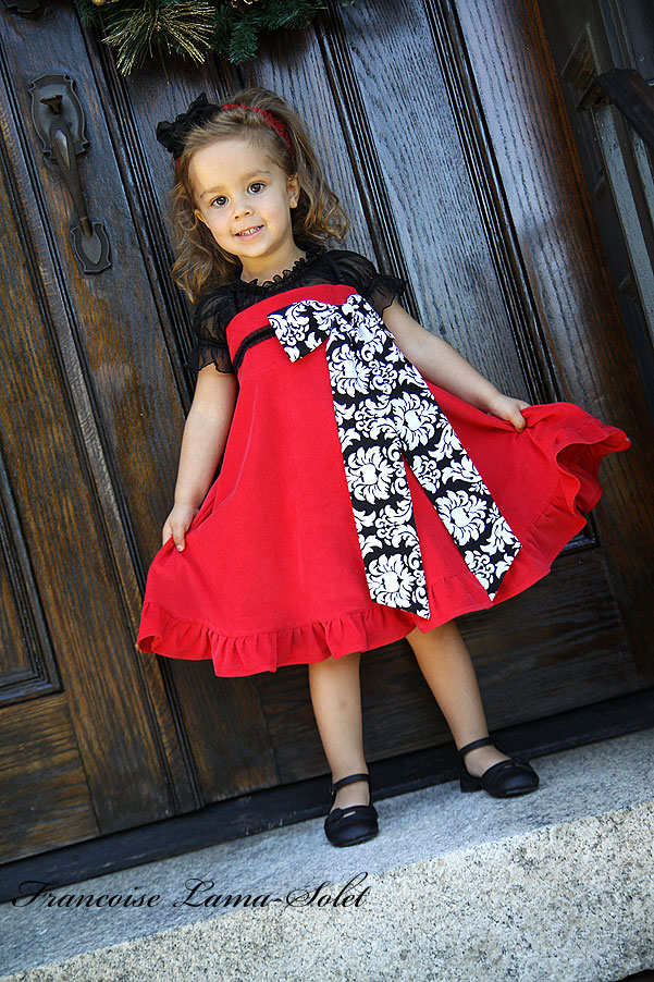 Girl's Christmas twirl dress handmade with red corduory and black and white damask Bella Milano