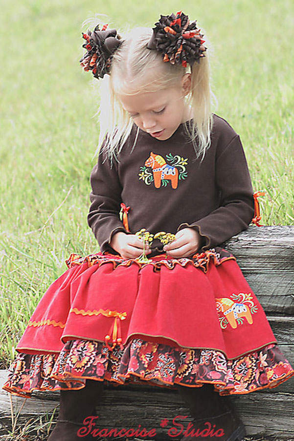 Girl's long sleeve brown t-shirt and ruffled twirl skirt embroidered with a Swedish dala horse Fall in Stockholm