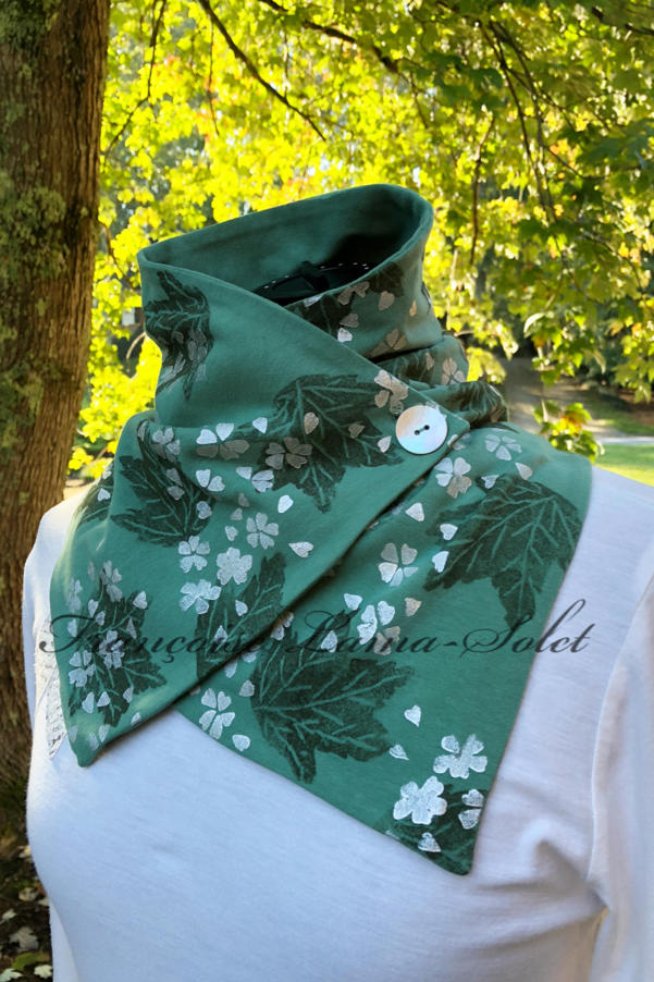 Button neck warmer scarf handmade with a sage green jersey and hand printed with green leaves and pearl cherry blossoms - Sage