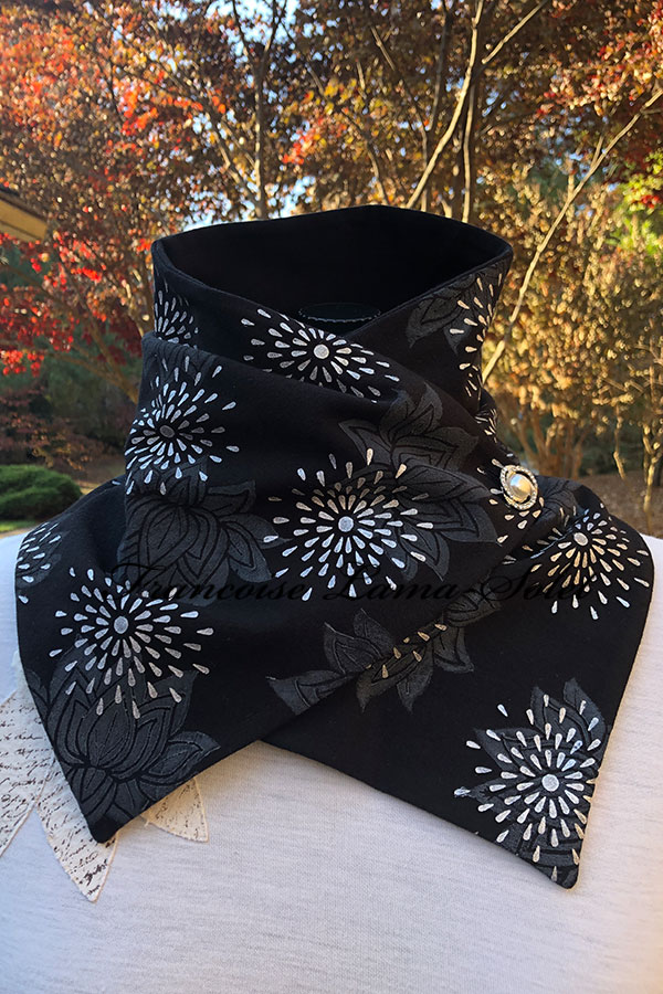 Women's button neck warmer scarf wrap handmade with a black cotton lycra jersey and hand printed with lotus flowers and white stars - Sophia